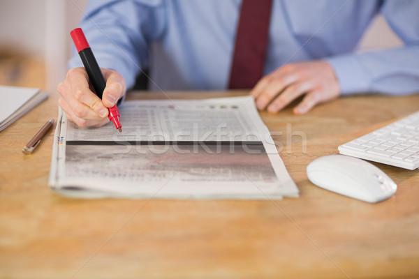 Businessman marking the newspaper with marker Stock photo © wavebreak_media