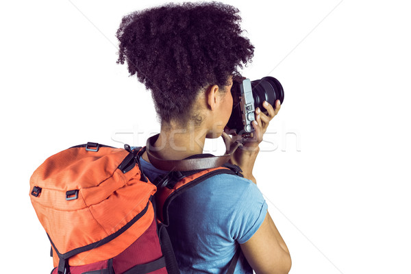 Young woman with backpack taking picture  Stock photo © wavebreak_media