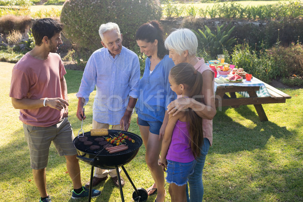 Family talking while preparing barbecue in the park Stock photo © wavebreak_media