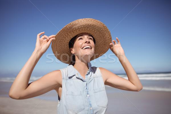 Happy woman wearing sun hat at beach Stock photo © wavebreak_media