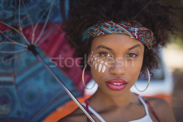 Stock photo: Close-up portrait of woman with umbrella