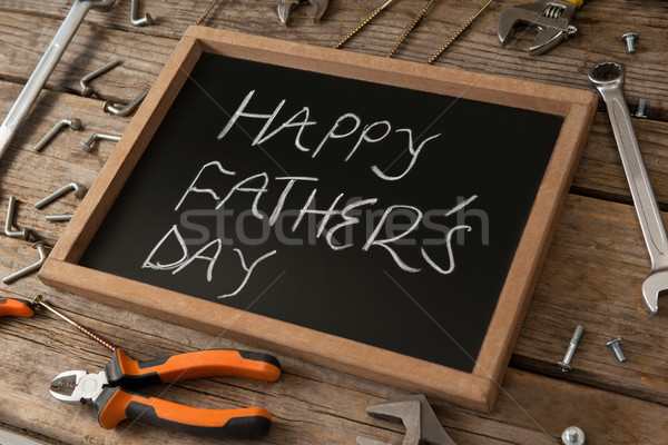 Close up of slate with happy fathers day text amidst hand tools Stock photo © wavebreak_media