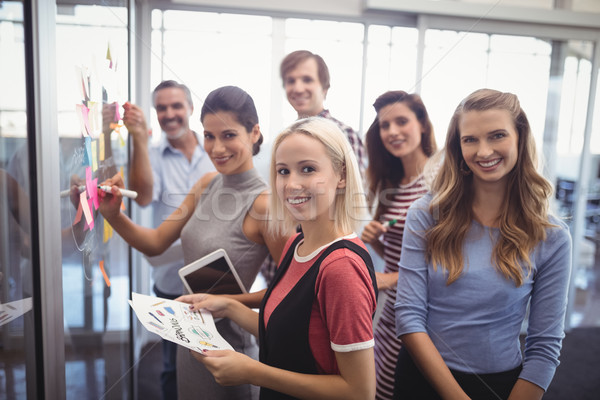Smiling business people planning in creative office Stock photo © wavebreak_media