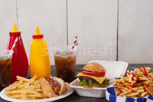 Stock photo: Drink and snacks on wooden table