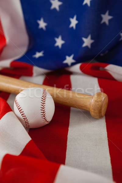 Baseball bat and ball on American flag Stock photo © wavebreak_media