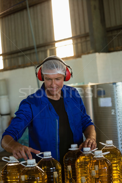 Worker checking a can of olives oil in factory Stock photo © wavebreak_media