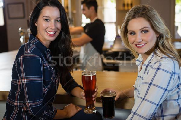 Portrait of female friends with bartender in background Stock photo © wavebreak_media