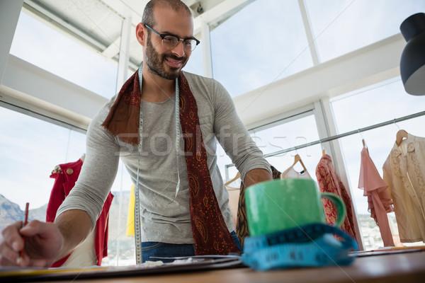 мнение улыбаясь дизайнера рабочих таблице Сток-фото © wavebreak_media