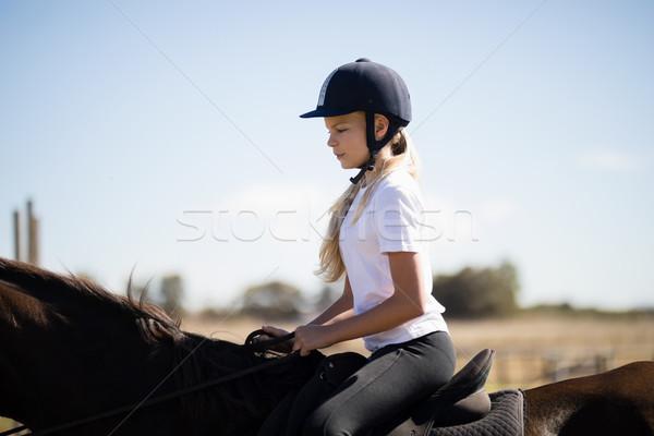 Nina equitación caballo rancho verano Foto stock © wavebreak_media
