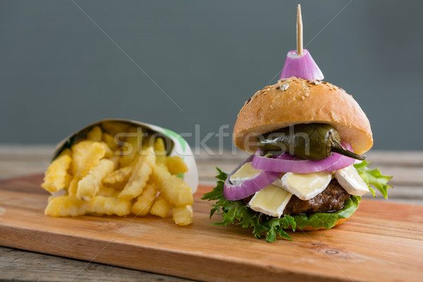 Burger by French fries in box on cutting board Stock photo © wavebreak_media