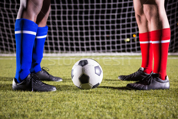 Low section of male players standing by soccer ball against goal post Stock photo © wavebreak_media