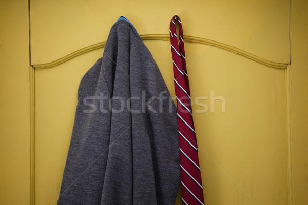 Iskolai egyenruha akasztás citromsárga ajtó közelkép ablak Stock fotó © wavebreak_media