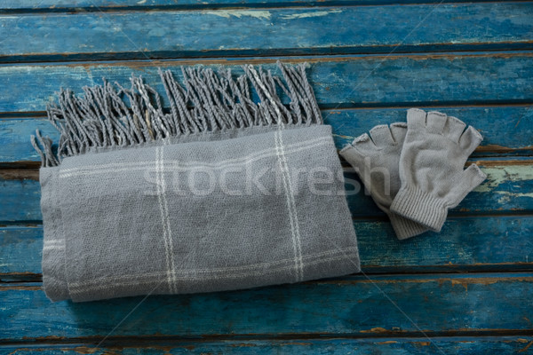 Overhead view of shawl and gloves on wooden table Stock photo © wavebreak_media