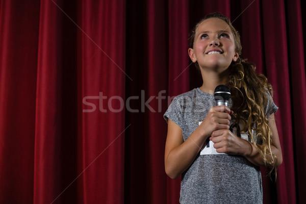 Gülen kız mikrofon sahne tiyatro Stok fotoğraf © wavebreak_media