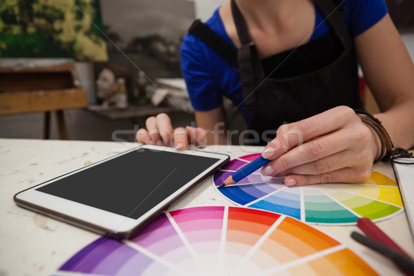 Stock photo: Mid section of woman matching color with color swatch