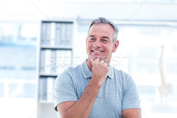 Sorridente massagista estância termal homem saúde Foto stock © wavebreak_media