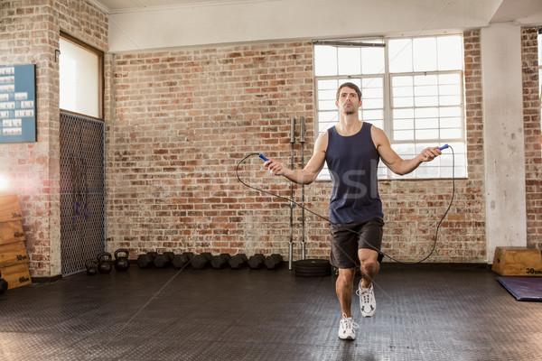 Man skipping wearing sportswear Stock photo © wavebreak_media