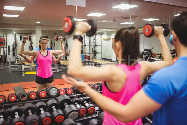 Fit couple working out in weights room Stock photo © wavebreak_media