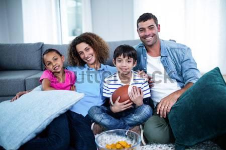 Happy family eating pizza on the sofa Stock photo © wavebreak_media