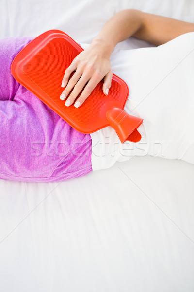 Femme lit ventre douleur maison Homme Photo stock © wavebreak_media