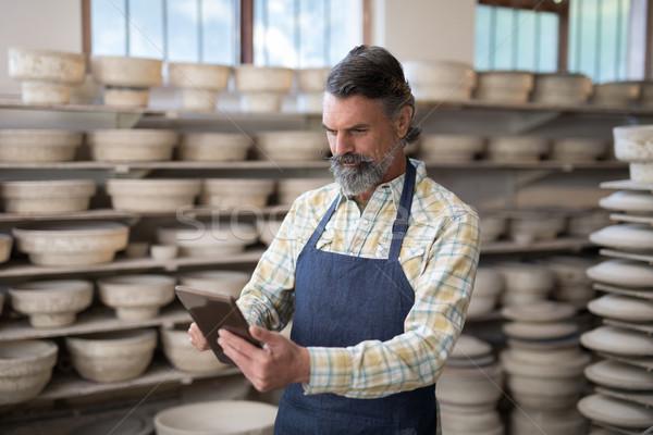 Male potter using digital tablet Stock photo © wavebreak_media