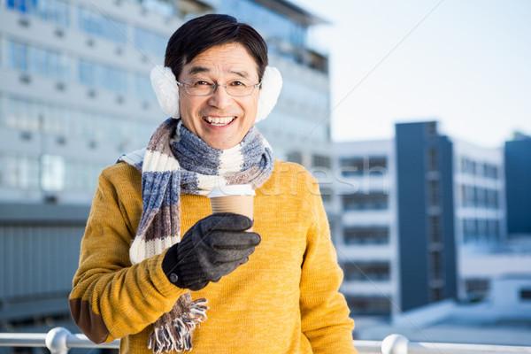 Older asian man with coffee to go Stock photo © wavebreak_media