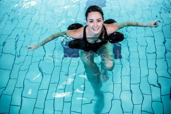 Fit smiling woman doing aqua aerobics Stock photo © wavebreak_media