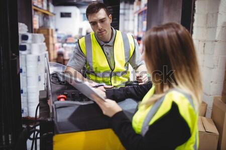 Warehouse worker looking at clipboard Stock photo © wavebreak_media