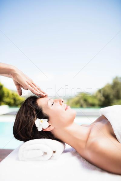Woman receiving a head massage from masseur Stock photo © wavebreak_media