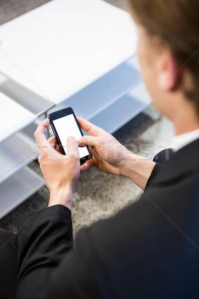 Businessman text messaging on smartphone Stock photo © wavebreak_media