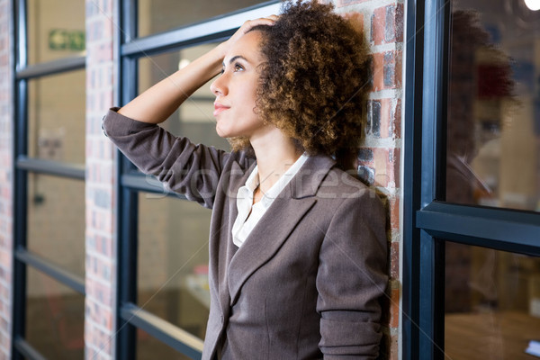 Frustrated businesswoman with hand on forehead Stock photo © wavebreak_media