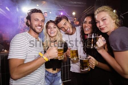 Glücklich Freunde halten Champagner Nachtclub Frau Stock foto © wavebreak_media