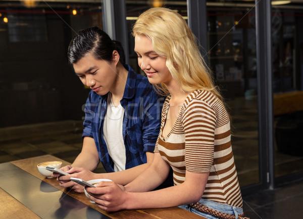 Stock photo: Couple using smartphones