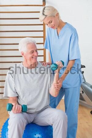 Infermiera pressione sanguigna senior uomo home femminile Foto d'archivio © wavebreak_media