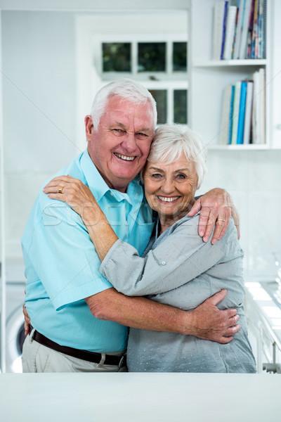 Happy senior couple embracing at home Stock photo © wavebreak_media