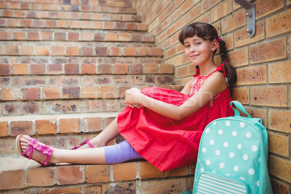 Sorridente aluna sessão escada menina Foto stock © wavebreak_media