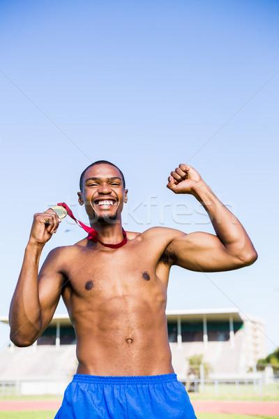 Atleta medalha de ouro feliz preto fita Foto stock © wavebreak_media