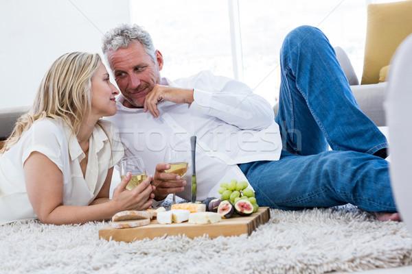 Romantikus pár fehérbor étel szőnyeg otthon Stock fotó © wavebreak_media