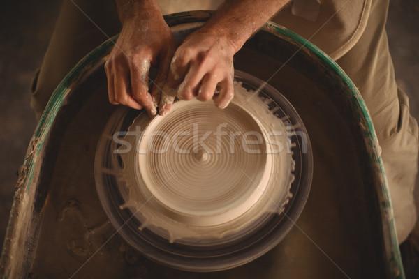 Hands of potter making a pot Stock photo © wavebreak_media