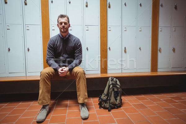 Mature student sitting in the locker room Stock photo © wavebreak_media