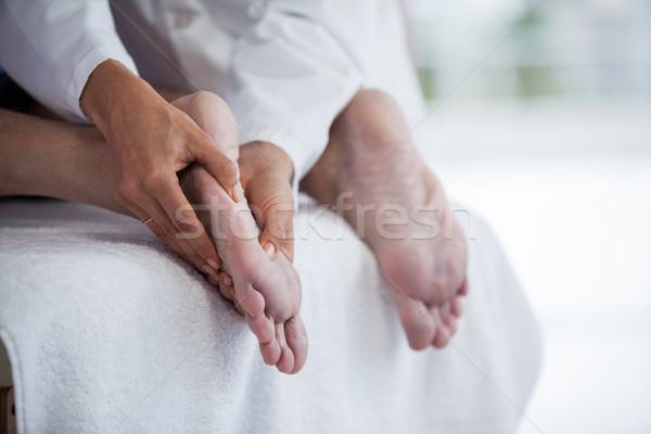 Altos hombre pie masaje mano viejo Foto stock © wavebreak_media