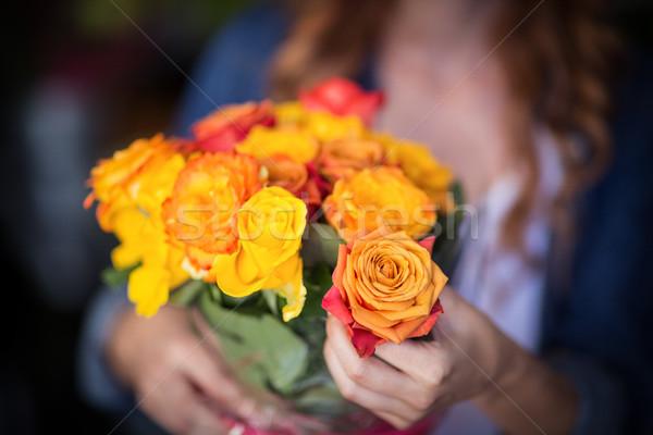 Female florist holding bunch of flowers Stock photo © wavebreak_media