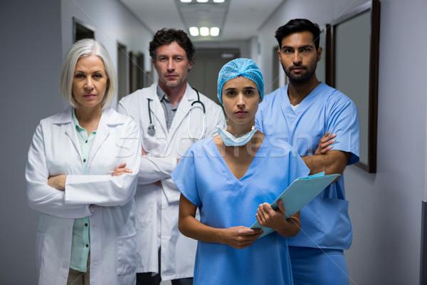 Portrait of surgeons and doctor standing in corridor Stock photo © wavebreak_media