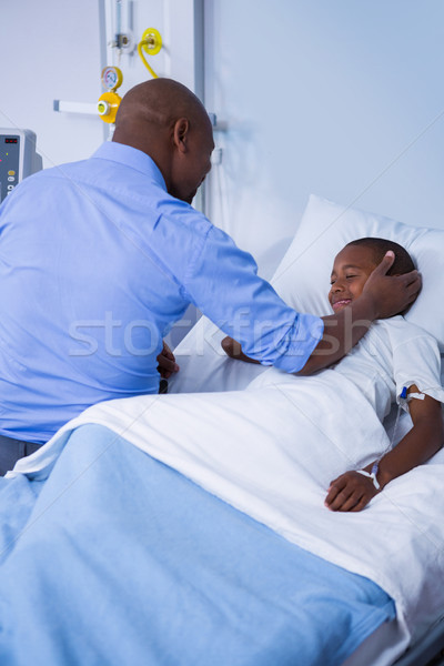 Male doctor consoling patient during visit in ward Stock photo © wavebreak_media
