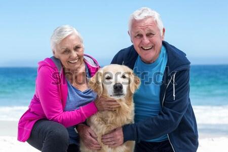 Portrait of couple with their pet dog Stock photo © wavebreak_media