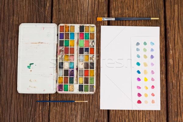 Сток-фото: краской · палитра · белый · бумаги · деревянный · стол · образование