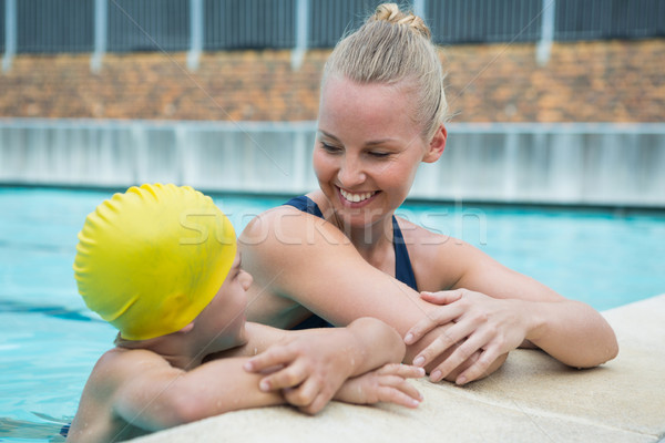 Female instructor and young boy relaxing at poolside Stock photo © wavebreak_media