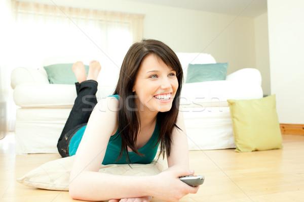 Stock fotó: Vidám · nő · tv · nézés · nappali · televízió · technológia