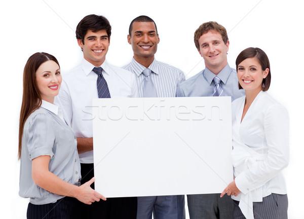 Glimlachend internationale bedrijfsleven mensen witte kaart Stockfoto © wavebreak_media