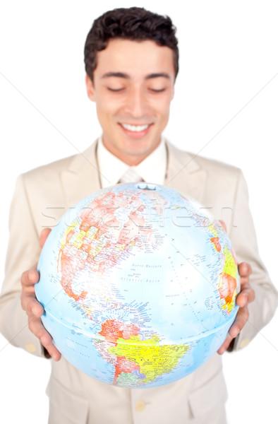 Positivo maschio executive guardando mondo isolato Foto d'archivio © wavebreak_media